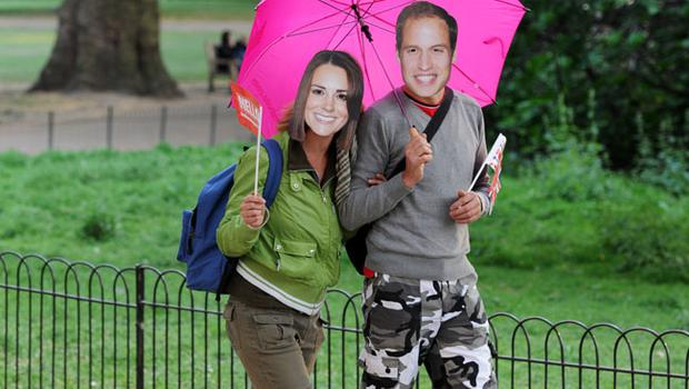 LONDON, ENGLAND - APRIL 28:  A couple strolls the Mall while wearing Prince William and Catherine Middleton masks ahead of tomorrow's marriage ceremony in Westminster Abbey on April 28, 2011 in London, England. With less than 24 hours to go final preparations for the wedding of Prince William and Catherine Middleton are in place.  (Photo by Jasper Juinen/Getty Images)