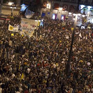 Thousands of demonstrators gather to protest at Puerta del Sol square in Madrid, Spain (AP/Alberto Di Lolli)