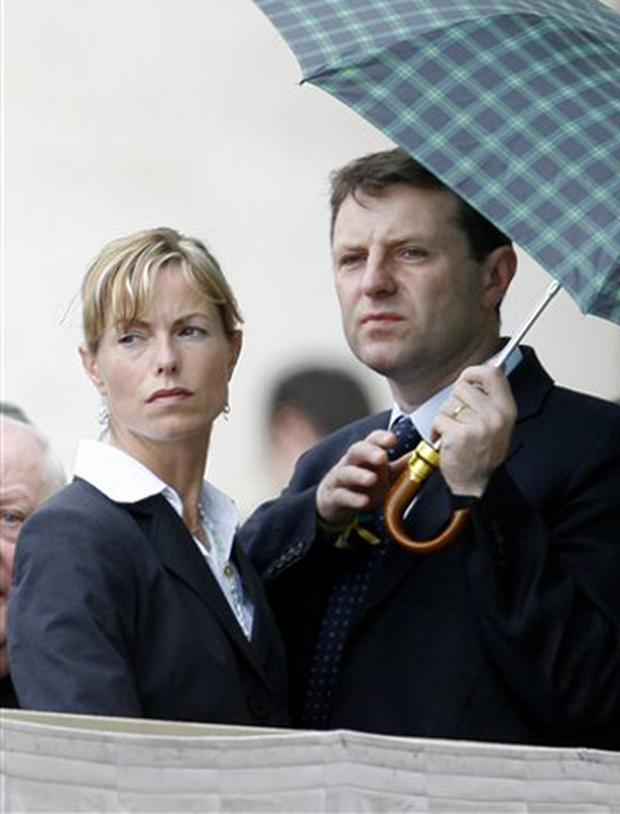 Gerry and Kate McCann, the parents of a 4-year-old British girl who disappeared while on a vacation with her family in Portugal on Thursday May 3, 2007, are seen in St. Peter square at the Vatican prior to the start of the weekly general audience, Wednesday, May 30, 2007, during wich Pope Benedict XVI held the hands of the parents of 4-year-old Madeleine, blessing them and a photo of the little girl.