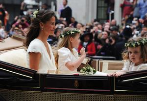 LONDON, ENGLAND - APRIL 29:  Pippa Middleton makes the journey by carriage after the wedding of Their Royal Highnesses Prince William, Duke of Cambridge and Catherine, Duchess of Cambridge to Buckingham Palace following their marriage at Westminster Abbey on April 29, 2011 in London, England. The marriage of the second in line to the British throne was led by the Archbishop of Canterbury and was attended by 1900 guests, including foreign Royal family members and heads of state. Thousands of well-wishers from around the world have also flocked to London to witness the spectacle and pageantry of the Royal Wedding.  (Photo by Jasper Juinen-WPA Pool/Getty Images)
