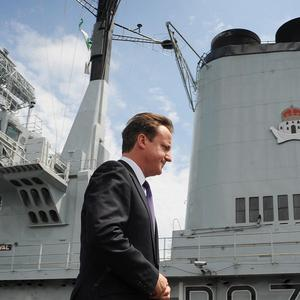 Prime Minister David Cameron on board HMS Ark Royal, which could be scrapped 'with immediate effect'