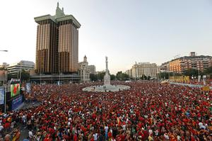 Supporters of the Spanish team attend a public viewing of the World Cup final football match between Spain and Netherlands at Plaza Colon on July 11, 2010 in Madrid, Spain