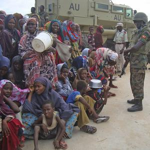 African union peacekeepers stand guard close to Somalian refugees affected by drought and famine (AP)