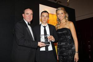 Paul Heatley was awarded the Carling Championship Player of the Year. Pictured presenting the award to Paul Heatley is Carling's Niall McMullan with Catherine Jennings
