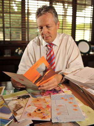 Peter Robinson with some of the messages of support he has been receiving