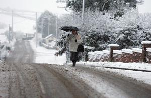 A woman makes her way to work in Carryduff February 2009