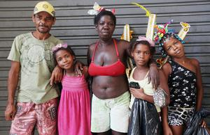 RIO DE JANEIRO, BRAZIL - FEBRUARY 19:  Members of the Juciara family pose while taking a break from gathering aluminum cans to earn money during Carnival celebrations on February 19, 2012 in Rio de Janeiro, Brazil. The family lives in a favela in the city. Carnival is the grandest holiday in Brazil, annually drawing millions in raucous celebrations culminating on Fat Tuesday before the start of the Catholic season of Lent which begins on Ash Wednesday. Police strikes in Salvador and Rio de Janeiro in recent weeks threatened Carnival and raised questions about the countryÄôs preparedness to host the upcoming 2014 World Cup and 2016 Summer Olympics. (Photo by Mario Tama/Getty Images)