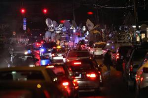 NEWTOWN, CT - DECEMBER 17:  Television trucks and traffic crowd a memorial on December 17, 2012 in Newtown, Connecticut. Twenty children and six adults were reportedly killed by Adam Lanza, after he entered the school and opened fire. The massacre was the second-deadliest school shooting in the United States after the 2007 Virginia Tech shooting. He reportedly killed his mother Nancy Lanza at their  Newtown home before driving to the school. After shooting the students and employees, he committed reportedly committed suicide.  (Photo by John Moore/Getty Images)