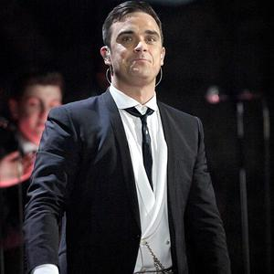 Robbie Williams and Take That are to announce a reunion