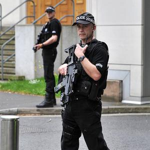 Armed police were on duty outside Manchester Crown Court as Kiaran Stapleton made his plea
