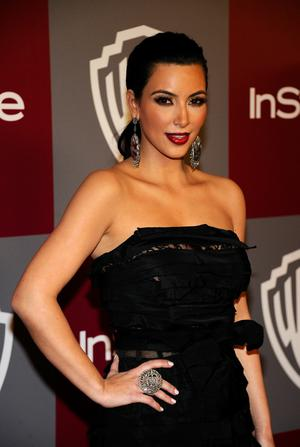 BEVERLY HILLS, CA - JANUARY 16:  Actress Kim Kardashian arrives at the 2011 InStyle And Warner Bros. 68th Annual Golden Globe Awards post-party held at The Beverly Hilton hotel on January 16, 2011 in Beverly Hills, California.  (Photo by Kevork Djansezian/Getty Images)
