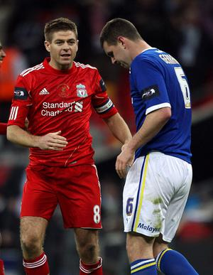 Liverpool's Steven Gerrard goes over to console his cousin Cardiff City's Anthony Gerrard after he misses the deciding penalty during the Carling Cup Final at Wembley Stadium, London