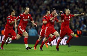 Liverpool's players celebrate winning the penalty shoot-out during the Carling Cup Final at Wembley Stadium, London
