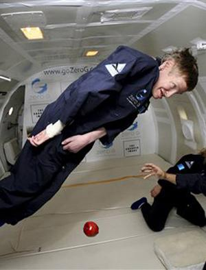 "In this photo provided by Zero Gravity Corp., astrophysicist Stephen Hawking floats on a zero-gravity jet, Thursday, April 26, 2007. The modified jet carrying Hawking, a handful of his physicians and nurses, and dozens of others first flew up to 24,000 feet over the Atlantic Ocean off Florida. Nurses lifted Hawking and carried him to the front of the jet, where they placed him on his back atop a special foam pillow. The plane made a total of eight parabolic dips, including two during which Hawking made two weightless flips like ""a gold-medal gymnast,"" said Peter Diamandis, chairman of Zero Gravity Corp., the company that owns the jet."