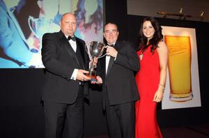 Carling Northern Ireland Football Writers Awards at the Europa Hotel in Belfast. Linfield boss David Jeffrey receives the Carling Manager of the Year award from Carling's Niall McMullan and Carling girl Melissa Patton