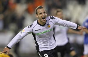 Valencia player Roberto Soldado from Spain celebrates after scoring during the Group C Champions League soccer match against Rangers FC at the Mestalla Stadium in Valencia, Spain, Tuesday, Nov. 2, 2010. (AP Photo/Fernando Bustamante)