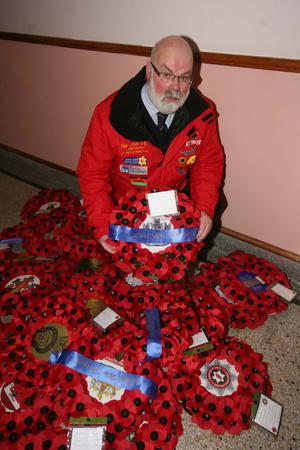 Coleraine town tall caretaker Davy Boyle with wreaths