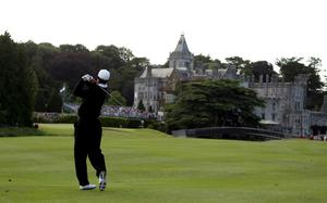 Tiger Woods of the USA hits his second shot on the 18th hole during the first round of The JP McManus Invitational Pro-Am event at the Adare Manor Hotel and Golf Resort on July 5, 2010 in Limerick