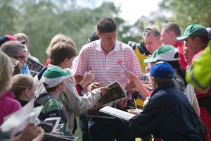 Former Republic of Ireland soccer player and current Sunderland FC chairman Niall Quinn signs autographs during the first round of The JP McManus Invitational Pro-Am event at the Adare Manor Hotel and Golf Resort on July 5, 2010 in Limerick