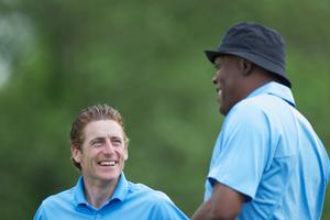 Jockey Johnny Murtagh (L) and Hollywood actor Samuel L. Jackson talk during the first round of The JP McManus Invitational Pro-Am event at the Adare Manor Hotel and Golf Resort on July 5, 2010 in Limerick