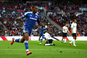 LONDON, ENGLAND - APRIL 15:  Didier Drogba of Chelsea celebrates as he scores their first goal during the FA Cup with Budweiser Semi Final match between Tottenham Hotspur and Chelsea at Wembley Stadium on April 15, 2012 in London, England.  (Photo by Michael Steele/Getty Images)