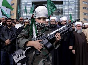 A Palestinian boy holds a toy rifle during a protest against the Israeli offensive in Gaza, near the U.N. headquarters in Beirut, Lebanon, Sunday, Nov. 18, 2012. (AP Photo/Bilal Hussein)