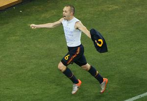 Andres Iniesta of Spain celebrates scoring the opening goal late into extra time during the 2010 FIFA World Cup South Africa Final match between Netherlands and Spain at Soccer City Stadium on July 11, 2010 in Johannesburg, South Africa