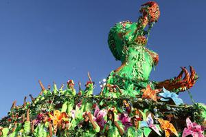 Dancers  perform on a float during the parade of Mancha Verde samba school in Sao Paulo, Brazil, Saturday, Feb. 18, 2012. (AP Photo/Andre Penner)
