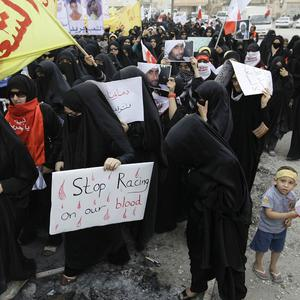 Protesters carry anti-F1 signs during a march against the Bahrain Grand Prix (AP)