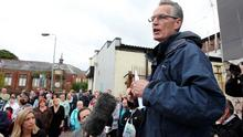 Sinn Féin MLA Gerry Kelly speaks to residents in Ardoyne during a rally at Brompton Park to highlight opposition against those who have been  rioting in the area