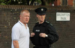 Ardoyne resident Eddie Copeland speaking with police last night - Ardoyne residents gather to protest about the recent rioting in the area July 2010