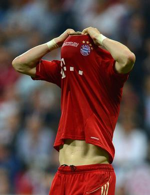 MUNICH, GERMANY - MAY 19:  Bastian Schweinsteiger of Bayern reacts after failing to score in the penalty shoot out during UEFA Champions League Final between FC Bayern Muenchen and Chelsea at the Fussball Arena München on May 19, 2012 in Munich, Germany.  (Photo by Lars Baron/Bongarts/Getty Images)