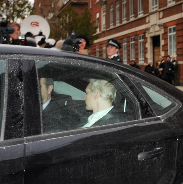 Wikileaks founder Julian Assange is driven into Westminster Magistrates Court in London after being arrested