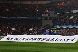 LONDON, UNITED KINGDOM - MARCH 16:  Chelsea players pay respect to the victims of the Japanese earthquake tragedy before the UEFA Champions League round of sixteen second leg match between Chelsea and FC Copenhagen at Stamford Bridge on March 16, 2011 in London, England.  (Photo by Clive Rose/Getty Images)