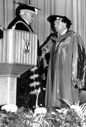VAN MORRISON:IRISH SINGER.Receiving an honorary doctorate of letter from Lord Grey of Naunton, Chancellor at the University of Ulster graduation ceremony at Jordanstown.