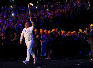 Steve Redgrave carries the Olympic flame into the stadium during the Opening Ceremony at  the 2012 Summer Olympics, Saturday, July 28, 2012, in London. (AP Photo/Cameron Spencer, Pool)