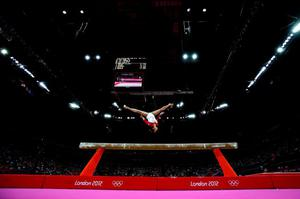Heem Wei Lim of Singapore performs on the beam in the Artistic Gymnastics Women's Team qualification on Day 2 of the London 2012 Olympic Games