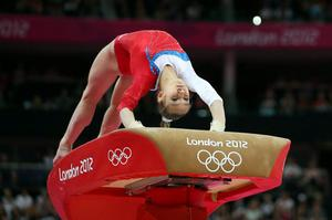 Victoria Komova of Russia competes on the vault in the Artistic Gymnastics Women's Team qualification on Day 2 of the London 2012 Olympic Games