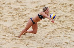 Laura Ludwig of Germany dives for the ball during Women's Beach Volleyball Preliminary match between Germany and Australia on Day 2 of the London 2012 Olympic Games