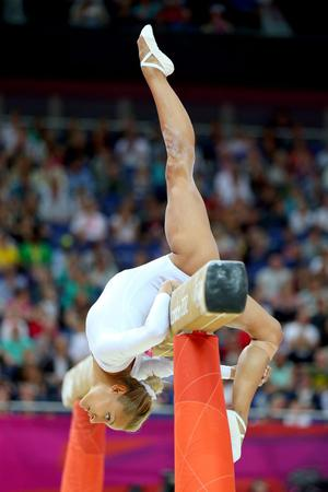 Vasiliki Millousi of Greece competes on the beam in the Artistic Gymnastics Women's Team qualification on Day 2 of the London 2012 Olympic Games