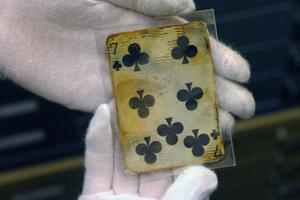 A seven of clubs card is shown as part of the artifacts collection at a warehouse in Atlanta, Friday, Aug 15, 2008. The 5,500-piece collection contains almost everything recovered from the wreckage of the RMS Titanic, which has sat 2.5 miles below the surface of the Atlantic ocean since the boat sank on April 15, 1912.