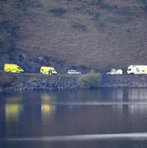 Emergency services at the scene at Clywedog reservoir, where four people died after the car they were in plunged into the water