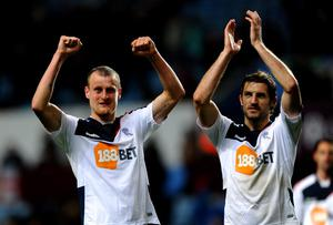 BIRMINGHAM, ENGLAND - APRIL 24:  David Wheater (L) and Sam Ricketts of Bolton Wanderers celebrate at the end of the Barclays Premier League match between Aston Villa and Bolton Wanderers at Villa Park on April 24, 2012 in Birmingham, England.  (Photo by Laurence Griffiths/Getty Images)