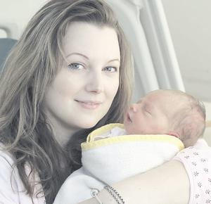 "Bundle of joy: Claire with her first-born Emily-Jane  <p><b>To send us your Baby Pics <a href=""http://www.belfasttelegraph.co.uk/usersubmission/the-belfast-telegraph-wants-to-hear-from-you-13927437.html"" title=""Click here to send your pics to Belfast Telegraph"">Click here</a> </a></p></b>"