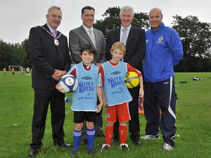 Castlereagh deputy mayor David Drysdale, Irwin's commercial controller Michael Murphy, Northern Ireland manager Nigel Worthington and the Irish FA's Grassroots development officer Phil Melville, are joined by two budding footballers from the Irish FA Nutty Krust Summer Soccer School at Belvoir