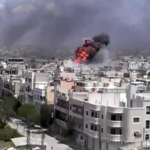 An explosion amid heavy shelling in the Khaldiyeh area of Homs, Syria (AP/Shaam News Network)