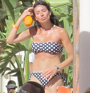 <b>No 1 CHRISTINE BLEAKLEY</b><br/> Rock-hard abs, check. Millionaire boyfriend, check. Mahogany tan, check! Telly babe Christine, 32, has it in the bag when it comes to beach style.  With her amazing figure and array of designer bikinis, Christine leaves her fellow WAGs in the shade. And, by the smile on the face of her fiancé Frank Lampard, he agrees that Christine is the number one beach babe!
