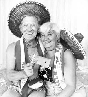 Billy Huddleston and his wife Bertha, of Groomsport, in a happy mood at the Northern Ireland match in Valencia. Billy won two free World Cup tickets taking in all Northern Ireland matches, in a draw organised by Portadown Masonic Recreation Club, in which there were 60,000 subscribers