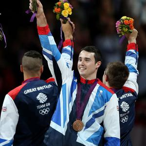 Great Britain's Kristian Thomas on the podium after winning the bronze medals during the artistic gymnastics team final