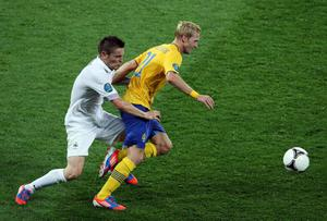 KIEV, UKRAINE - JUNE 19:  Christian Wilhelmsson of Sweden is challenged by Mathieu Debuchy of France during the UEFA EURO 2012 group D match between Sweden and France at The Olympic Stadium on June 19, 2012 in Kiev, Ukraine.  (Photo by Ian Walton/Getty Images)